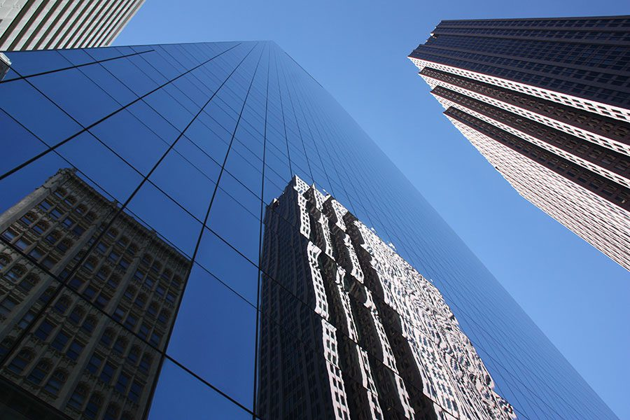 Business Insurance - Closeup View of Modern Glass Skyscrapers in Downtown Philadelphia Against a Blue Sky