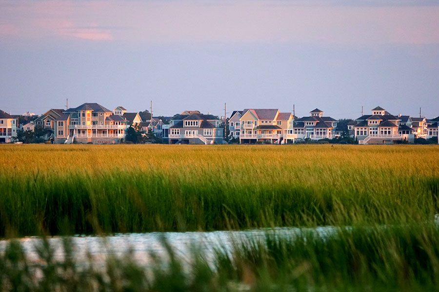 Homepage - View of Waterfront Homes and Tall Green Grass by the Coast in Delaware