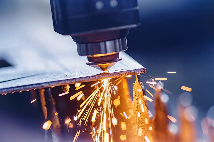 Machine Shop Insurance - Welding Metal to a New Machine with Sparks Flying