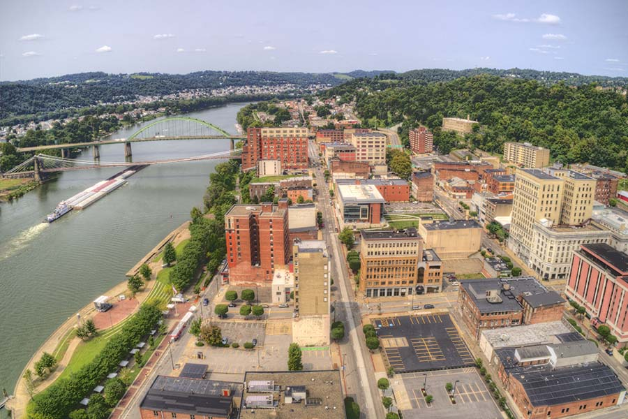 Ohio - Aerial View of City Next to the River in Ohio with View of Residential and Commercial Buildings