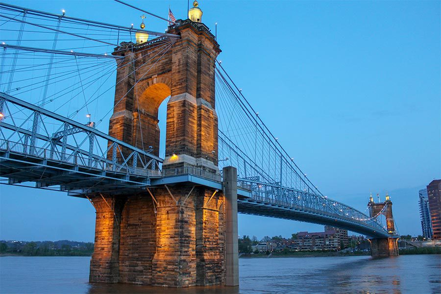 Crestview Hills, KY Insurance - View of the John a. Roebling Suspension Bridge Connecting Ohio and Kentucky Across the Ohio River, Lit up at Dusk