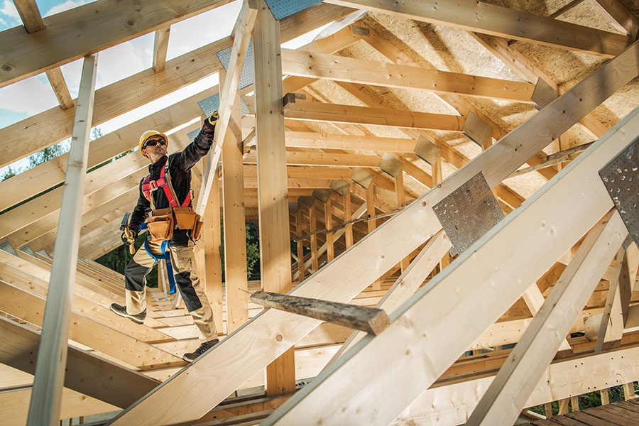 Specialized Business Insurance - View of a Contractor Working on Framing a New Roof for a Home