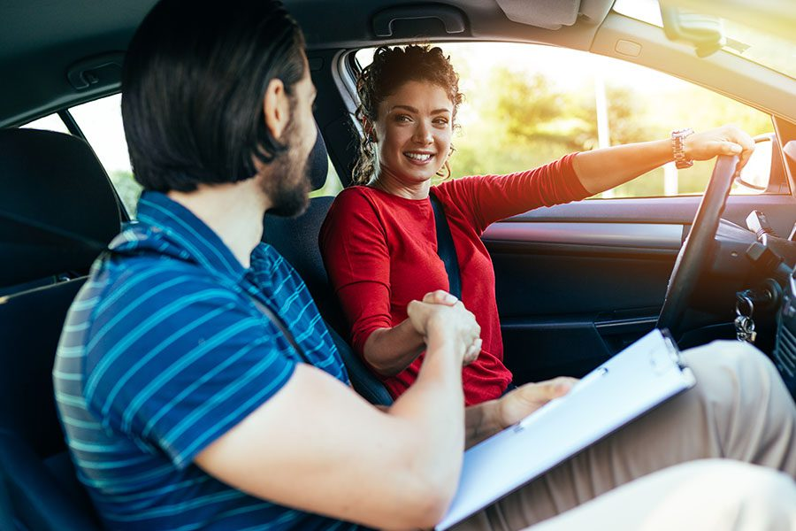 Driving School Insurance - Teenager Getting Her Driving Test Done with a Driving School