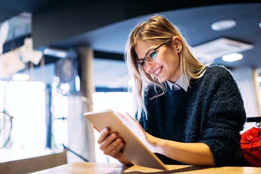 Client Center - Portrait of Young Woman Using Tablet in the Office