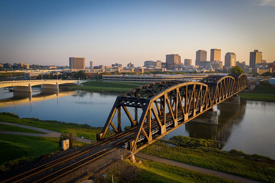 About Our Agency - View of Bridge Across the River and Surrounding View of Dayton Ohio at Sunset