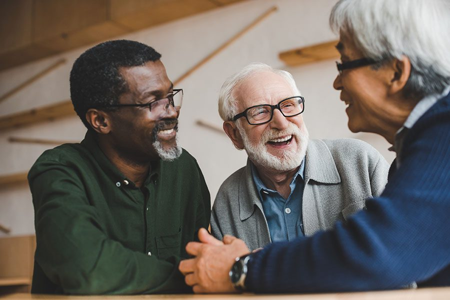Employee Benefits - Group of Smiling Seniors Hanging Out at a Restaurant