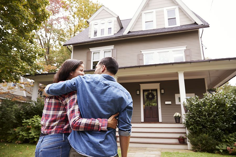 Personal Insurance - View of Happy Couple Looking at Their New Two Story Home