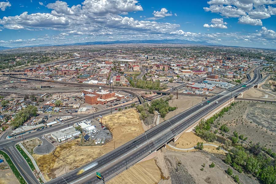 Pueblo CO - Aerial View of the City of Pueblo Colorado on a Sunny Day with a Bright Blue Cloudy Sky