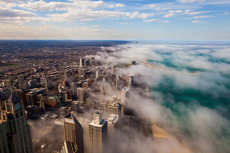 Chicago, IL Insurance - Aerial View of Chicago Area and Lake Michigan With Mist Floating Over the City