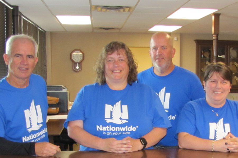About Our Agency - Portrait of Sheward Fulks Agency Staff Standing in the Office Wearing Nationwide Shirts