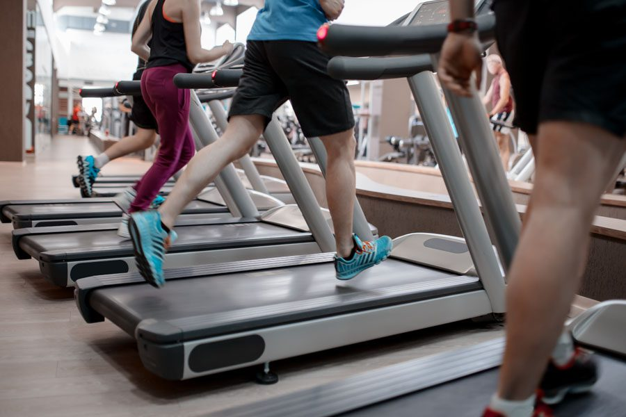 Fitness Center Insurance - People Running on the Treadmill at the Gym