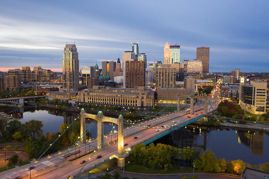 About Our Agency - Minneapolis, Minnesota Seen From Above, a Busy Bridge in the Foreground