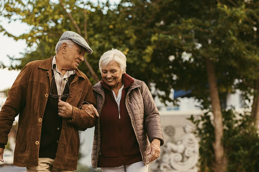 Blog - Happy Retired Seniors Walking Outdoors on a Winter Day