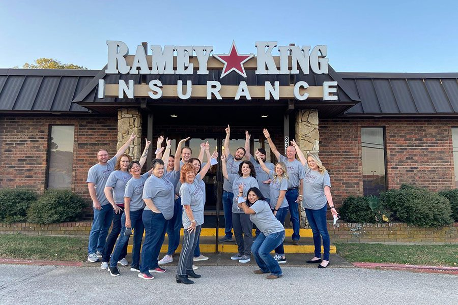 About Our Agency - Portrait of Ramey King Insurance Staff Standing Outside the Office Building