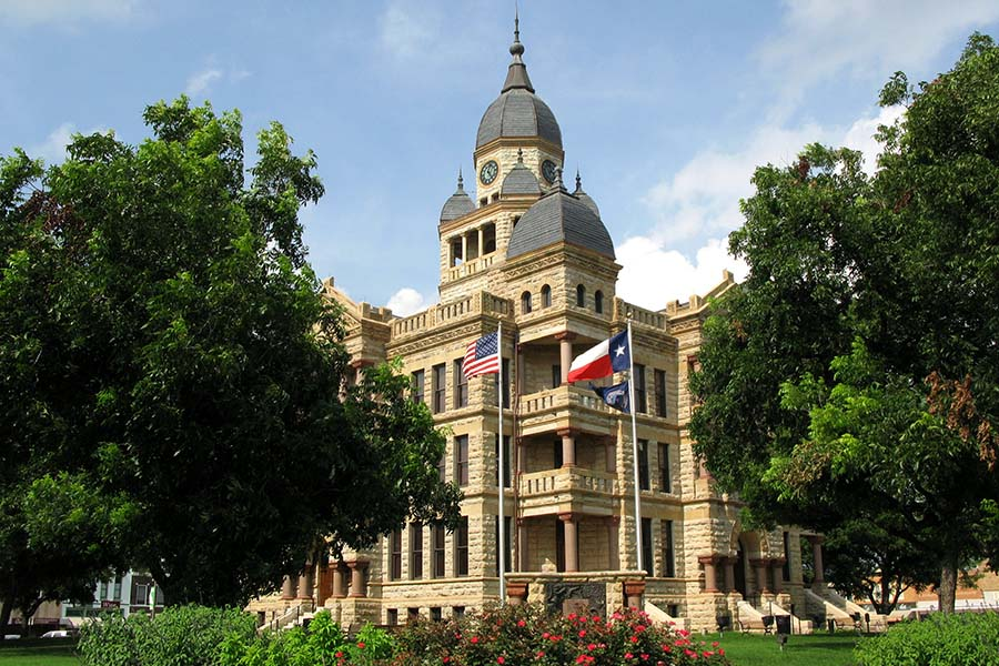Denton TX - View of Courthouse in Denton Texas Surrounded by Green Trees