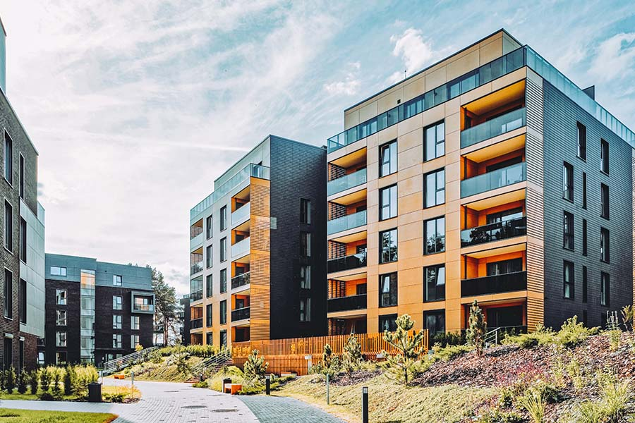 Specialized Business Insurance - View of Modern Multi Family Apartment Buildings on a Sunny Day