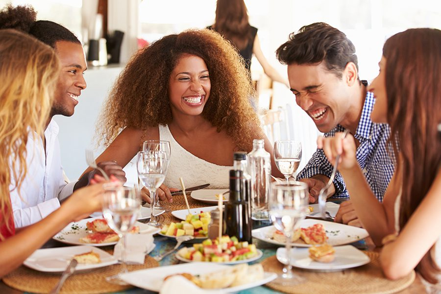Specialized Business Insurance - Group of Happy Friends Enjoying Lunch Together at a Restaurant