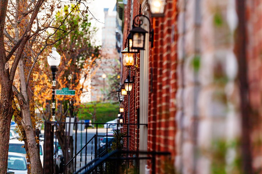 Silver Spring, MD - Closeup and Angled View of Red Brick City Houses with Lamp Lighting