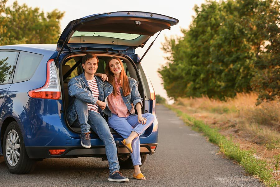 Blog - Couple Sitting in the Tailgate of Their Car on a Back Country Road