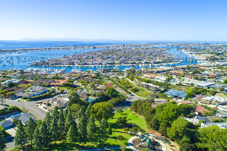 Contact - Aerial View of Irvine, California and Surrounding Orange County on a Sunny Day