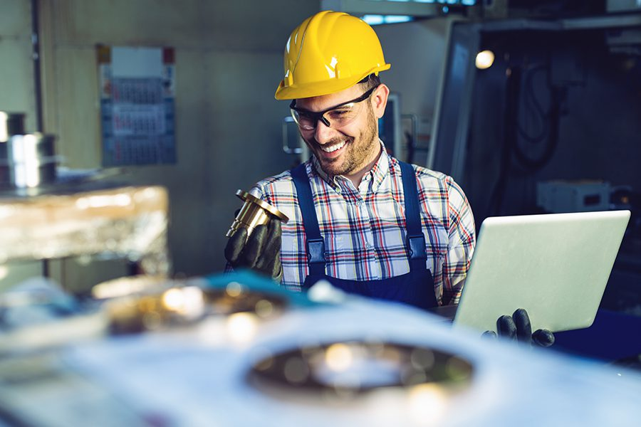 Mechanical Contractor Insurance - Mechanical Contractor Technician Measuring with Caliper in a Workshop