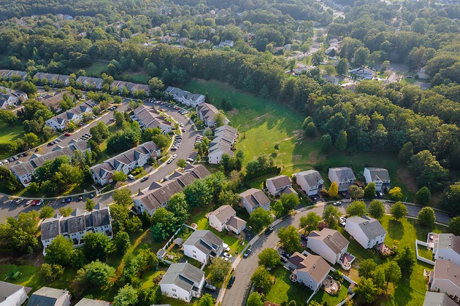 Bellbrook OH - Aerial View of a Residential Neighborhood in the Suburbs with Surrounding Green Foliage in Bellbrook Ohio
