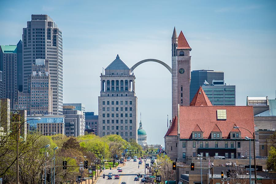About Our Agency - View of Downtown St. Louis on a Sunny Day, Cars Driving Along With Highrises on Each Side