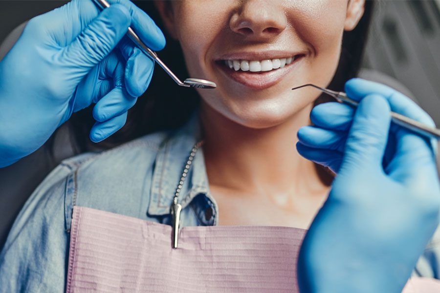 Individual Dental Insurance - Woman Getting Her Teeth Cleaned