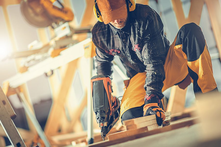 Specialized Business Insurance - Angled View of Construction Worker with Nail Gun in His Hand Working on Floor