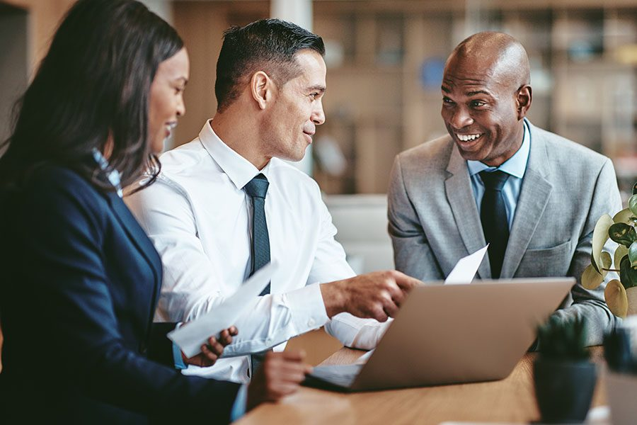 Commercial Surety Bonds - Businesspeople Working Together in a Modern Office