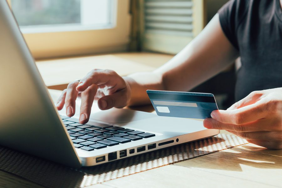 Pay Bill - Person Using a Credit Card to Pay for Insurance
