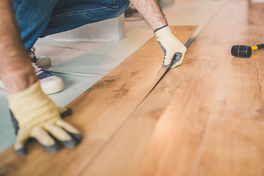 Flooring Contractor Insurance - Closeup of a Professional Flooring Installation by a Flooring Contractor