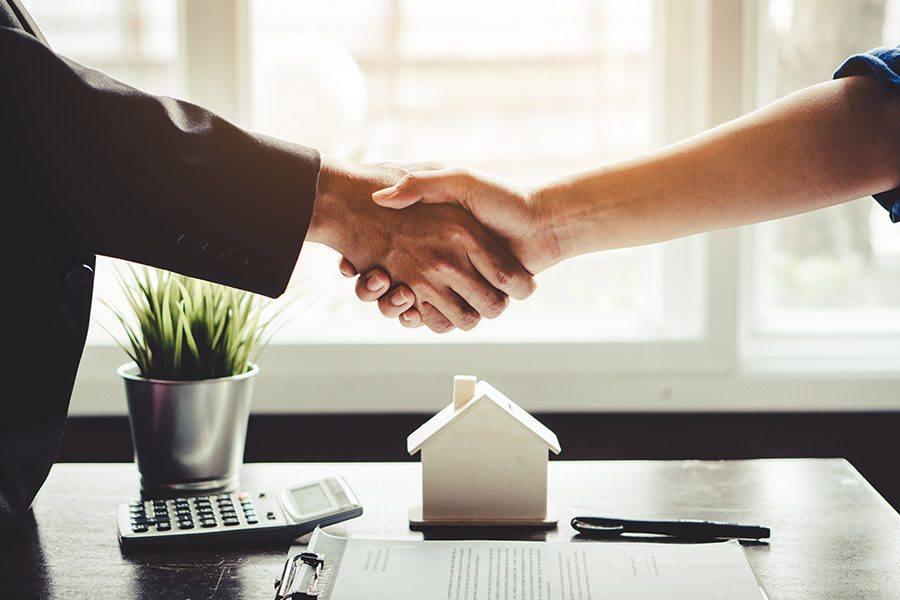 Downloadable Forms - Agent and Client Shaking Hands After Signed Document