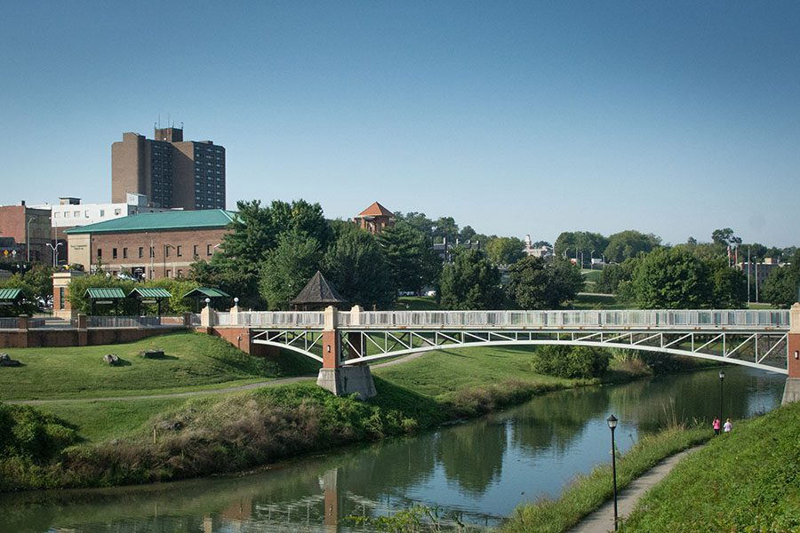 Maryville TN - View of Park Walking Bridge and River with Buildings in the Background in Maryville Tennessee