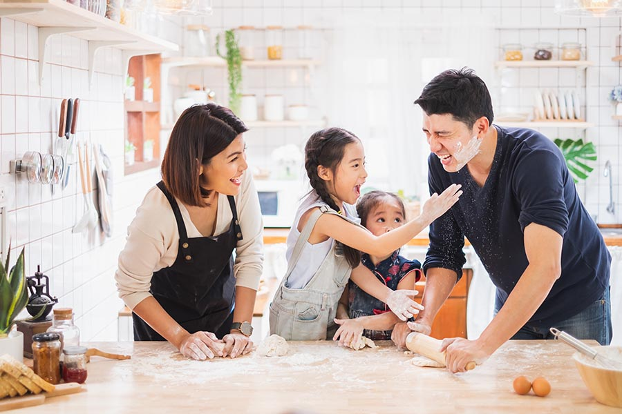 East Liverpool, OH - Family Enjoy Playing and Cooking Food in Kitchen at Home