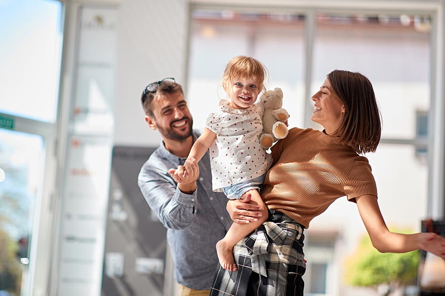 Personal Insurance - Family Dancing and Having Fun in Morern Home