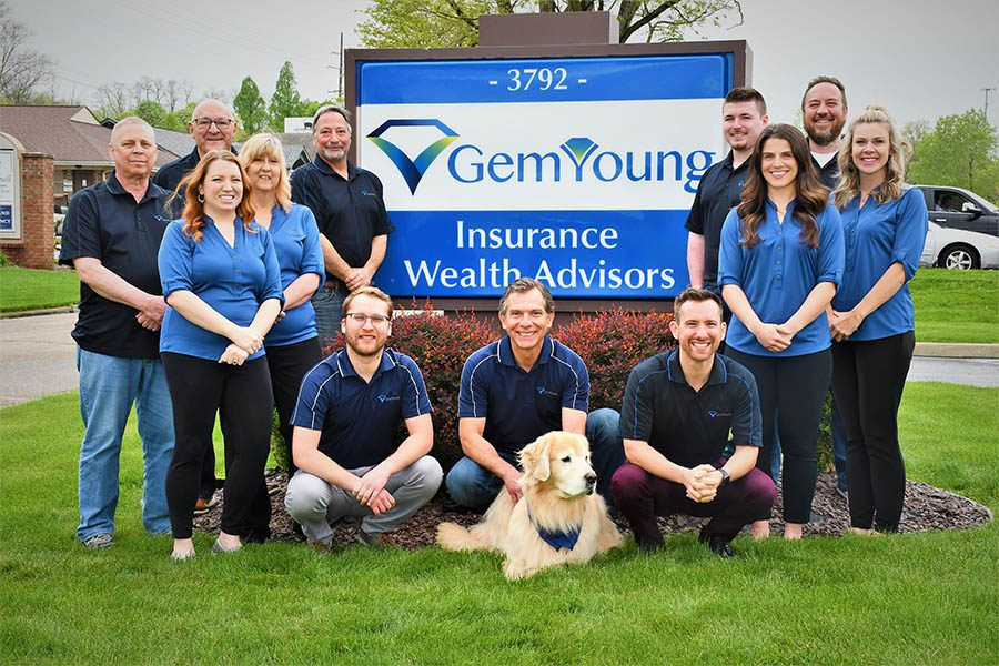 Wealth Advisors Portrait of the Gem Young Insurance Wealth Advisors Team Outside in Front of Office Sign May 2021