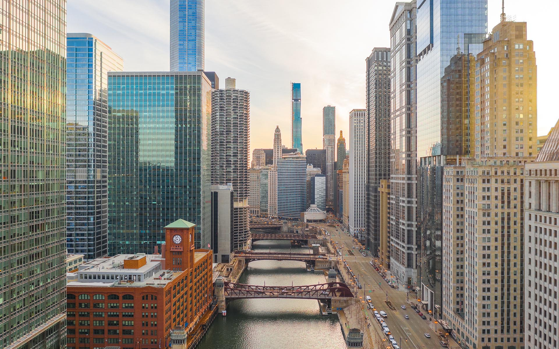 Client Center - Downtown Chicago at Dawn, the Chicago River Crossed by Bridges, Large High Rises Lining the Banks