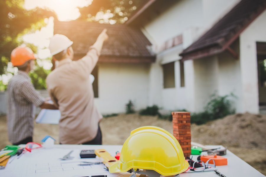 Contractor Insurance - Contractor Discussing Housing Plans