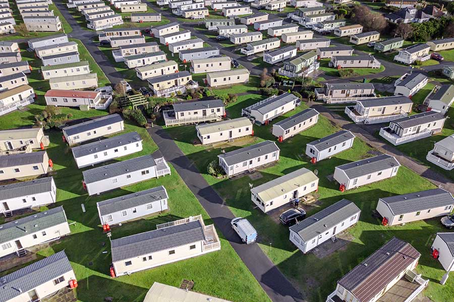 Mobile Home Park Insurance - Mobile Home Park with Bright Green Grass and Hundreds of Homes