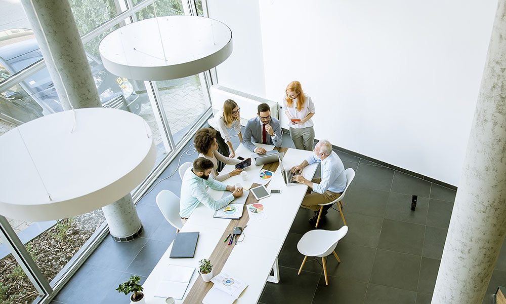 News and Updates - Group of Employees Sitting in Modern Office During Team Meeting