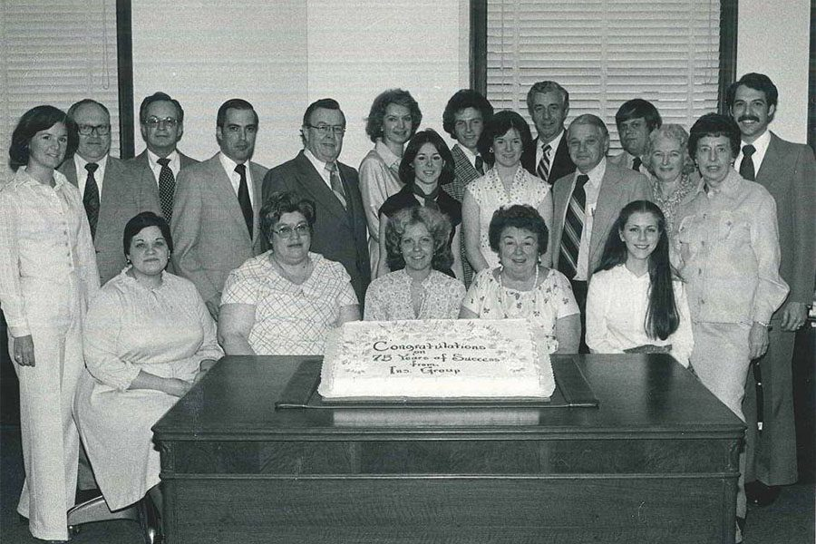 About Our Agency - Black and White Portrait of the Evarts Tremaine Team Celebrating 75 Years of Success in the Company
