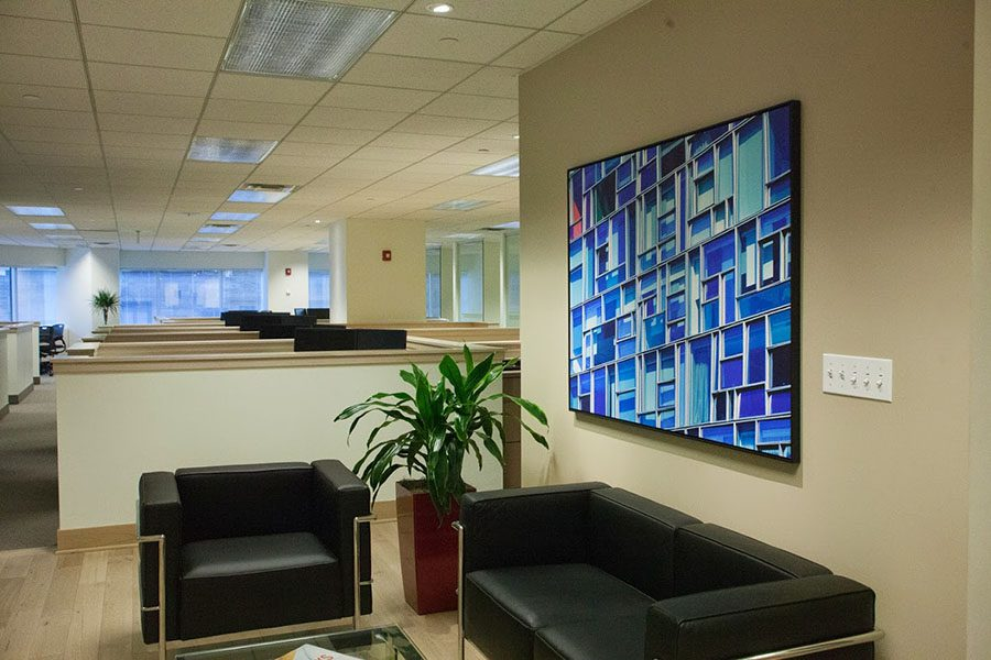 Client Feedback - Closeup View of a Waiting Room Area with a Mosaic Portrait on the Wall Inside the Evarts Tremaine Office Building