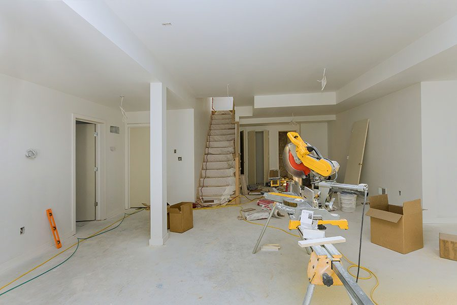 Contractor Insurance - View of a Circular Saw Sitting in a Room Inside a House That is Being Remodeled