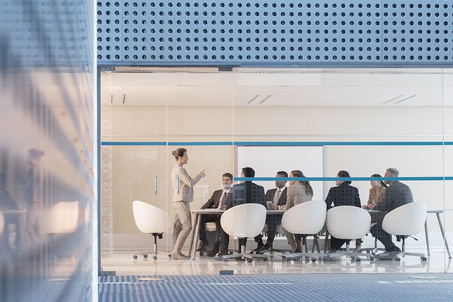 Our Keystone Partnership - View of a Businesswoman Leading a Group Meeting in a Modern Office