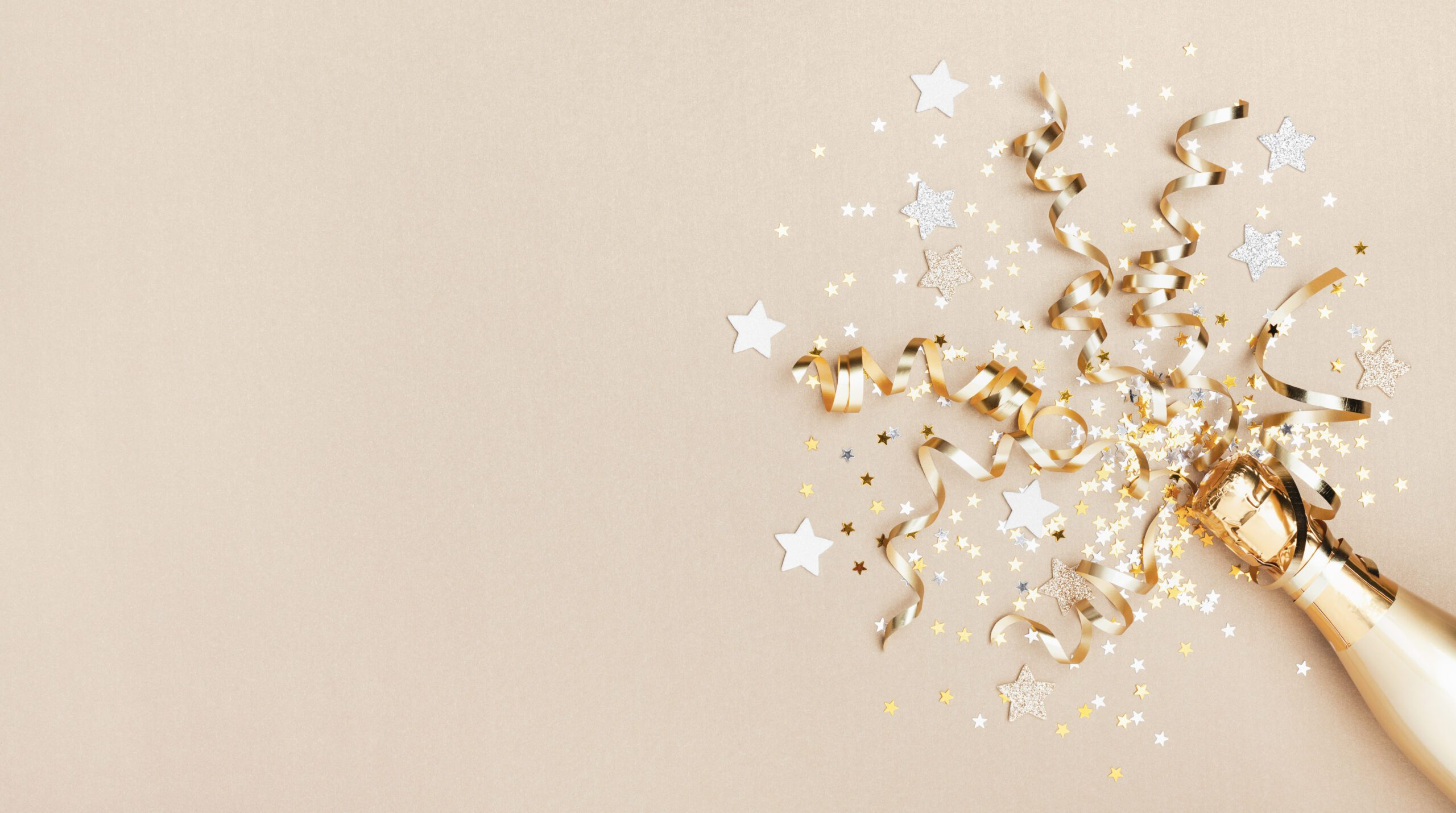 Celebration background with golden champagne bottle, confetti stars and party streamers.