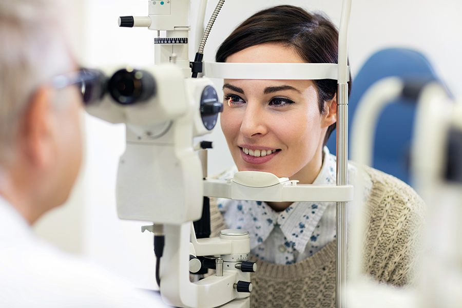 Individual Vision Insurance - Optometrist Examining the Eyesight of a Woman Patient