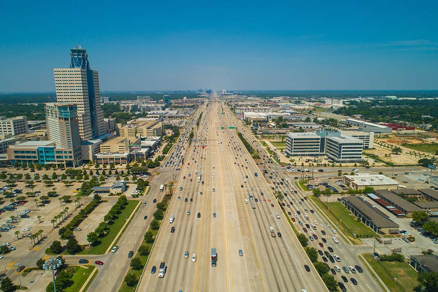Katy TX - Aerial View of Commercial Buildings Along a Busy Highway in Katy Texas on a Sunny Day