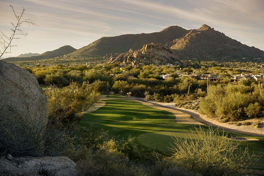 Scottsdale AZ - View of Green Golf Course and Surrounding Neighborhood with Homes Next to a Rock Cliff in Scottsdale Arizona