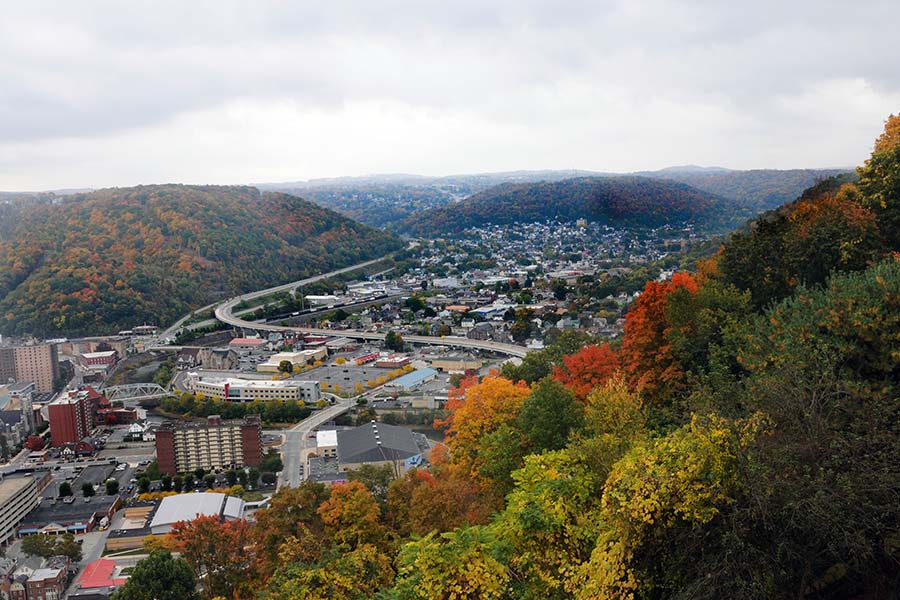 Lock Haven PA - Aerial View of the Town of Lock Haven Pennsylvania Surrounded by Mountains with Colorful Fall Foliage